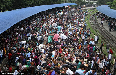 There's actually a train under there... Mass of people try to get on board as millions celebrate the end of Ramadan  Article-2386458-1B328FCE000005DC-646_634x414