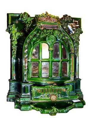 பழமை மாறாத கணப்படுப்புகள் {Antique Stove} Antique-stoves-09