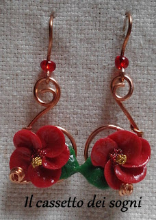 Pendente rose rosse + orecchini vari. Ibisco