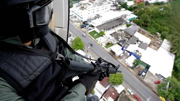 Derriban helicóptero de la Policía Federal en Michoacán Policias-agresion