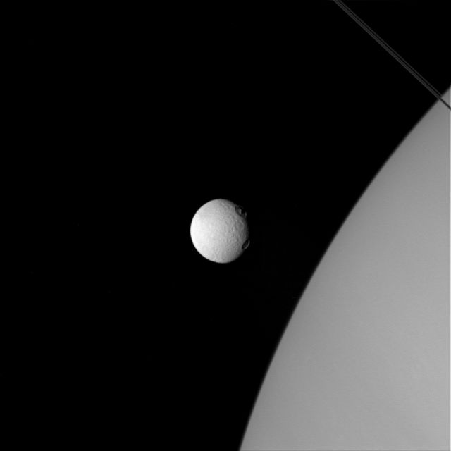 Saturn's Moon Tethys looks different! Something happened with Tethys? Tethys%2Bsaturn%2Bmoon%2Bnasa%2B%25282%2529