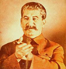Stalin - Acerca de las tres consignas Aplaudiendo