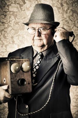 ΤΗΛΕΦΩΝΟ 4140284-84702-image-of-a-old-fashioned-vintage-business-man-standing-in-a-office-communicating-to-the-exchange-through-a-retro-box-telephone-in-a-technology-concept