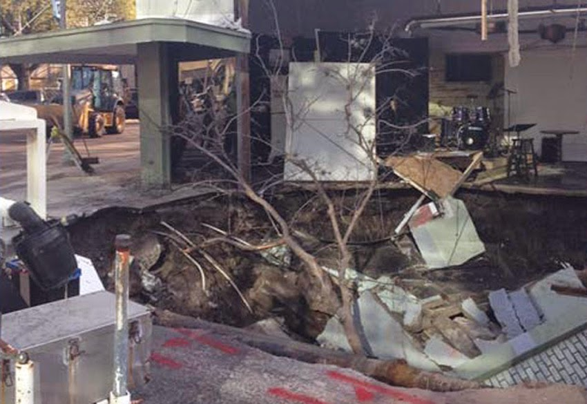 GEOLOGICAL UPHEAVAL: Sinkholes Keep Popping Up Across The United States - Massive Sinkhole Opens Up In St. Petersburg, Florida; Swallows Street Corner And Part Of A Building!  Florida_sinkhole10