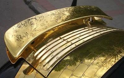 Trovate bizzarre delle marche automobilistiche Gold-porsche-911-996-cabriolet-2