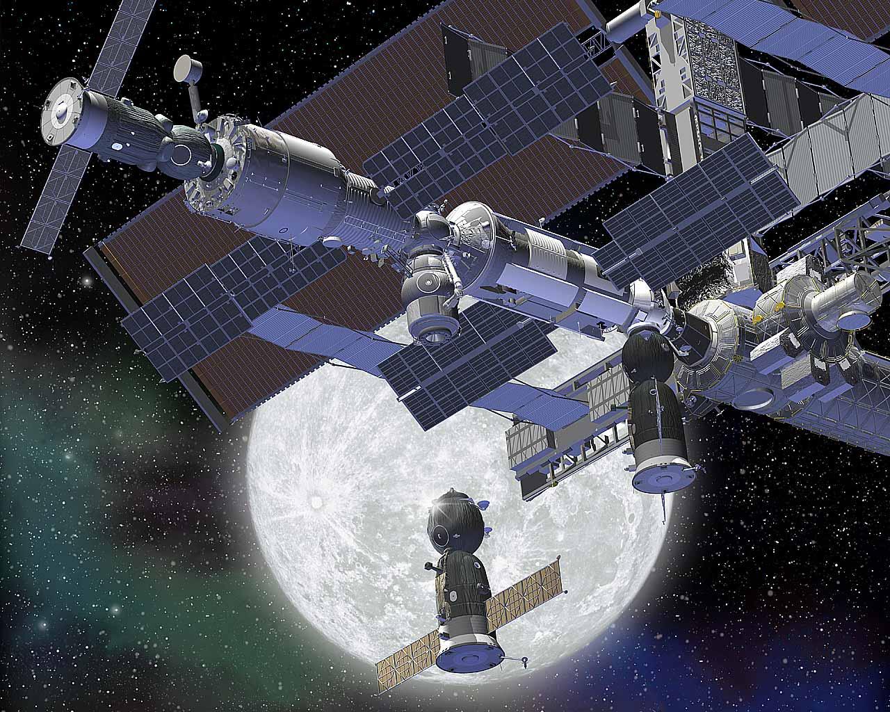 Los  gigantescos éxitos de la Unión Soviética - Página 2 Soyuz-iss-moon-docking-wallpaper