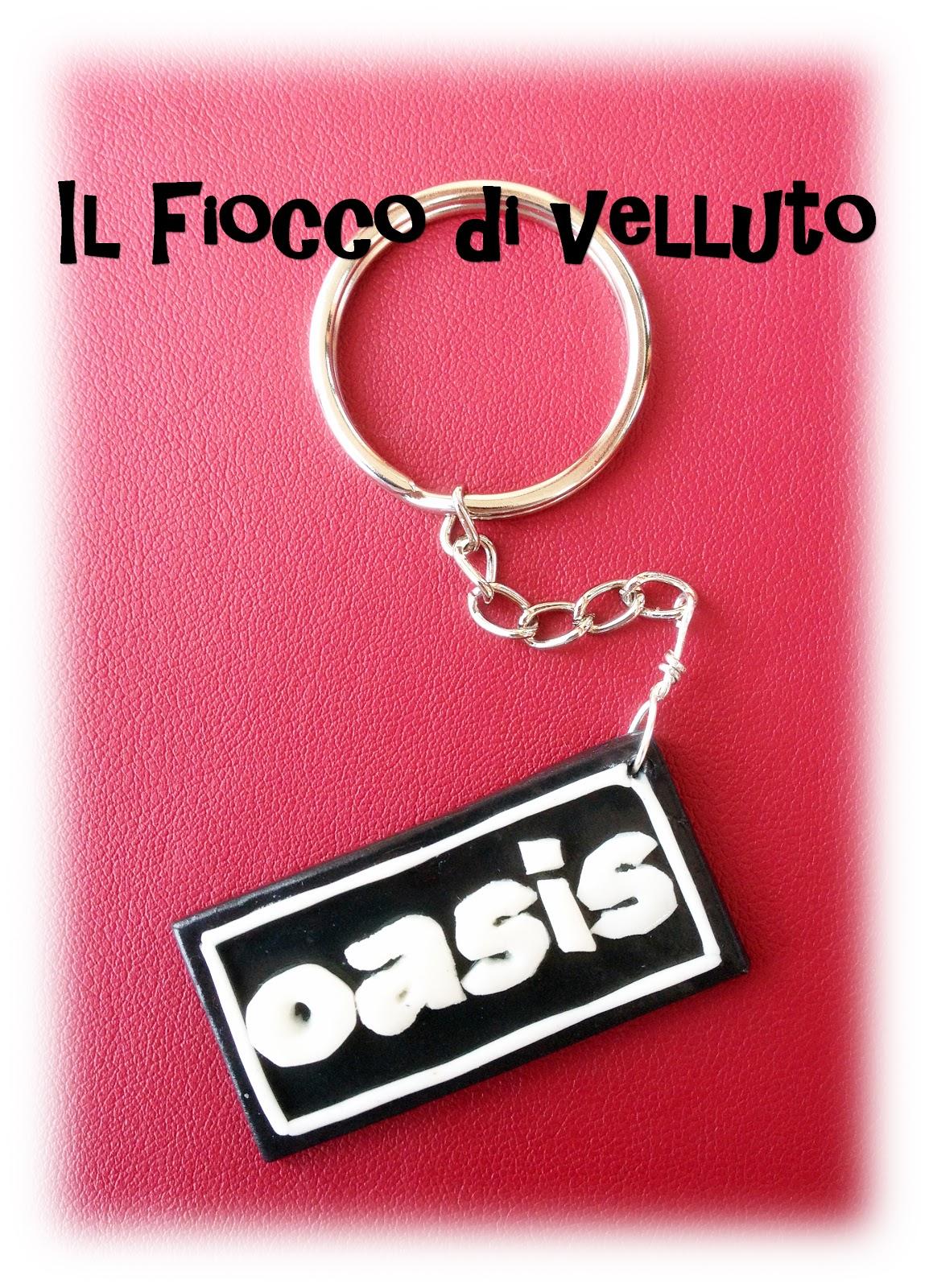 Portachiavi con logo degli Oasis Oasis