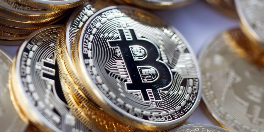 World Governments Afraid of Bitcoin Because They Can't Tax it – John McAfee Bitcoin-900x450