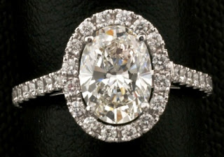 مجوهرات رقة ونعومة 1_carat_oval_diamond_ring