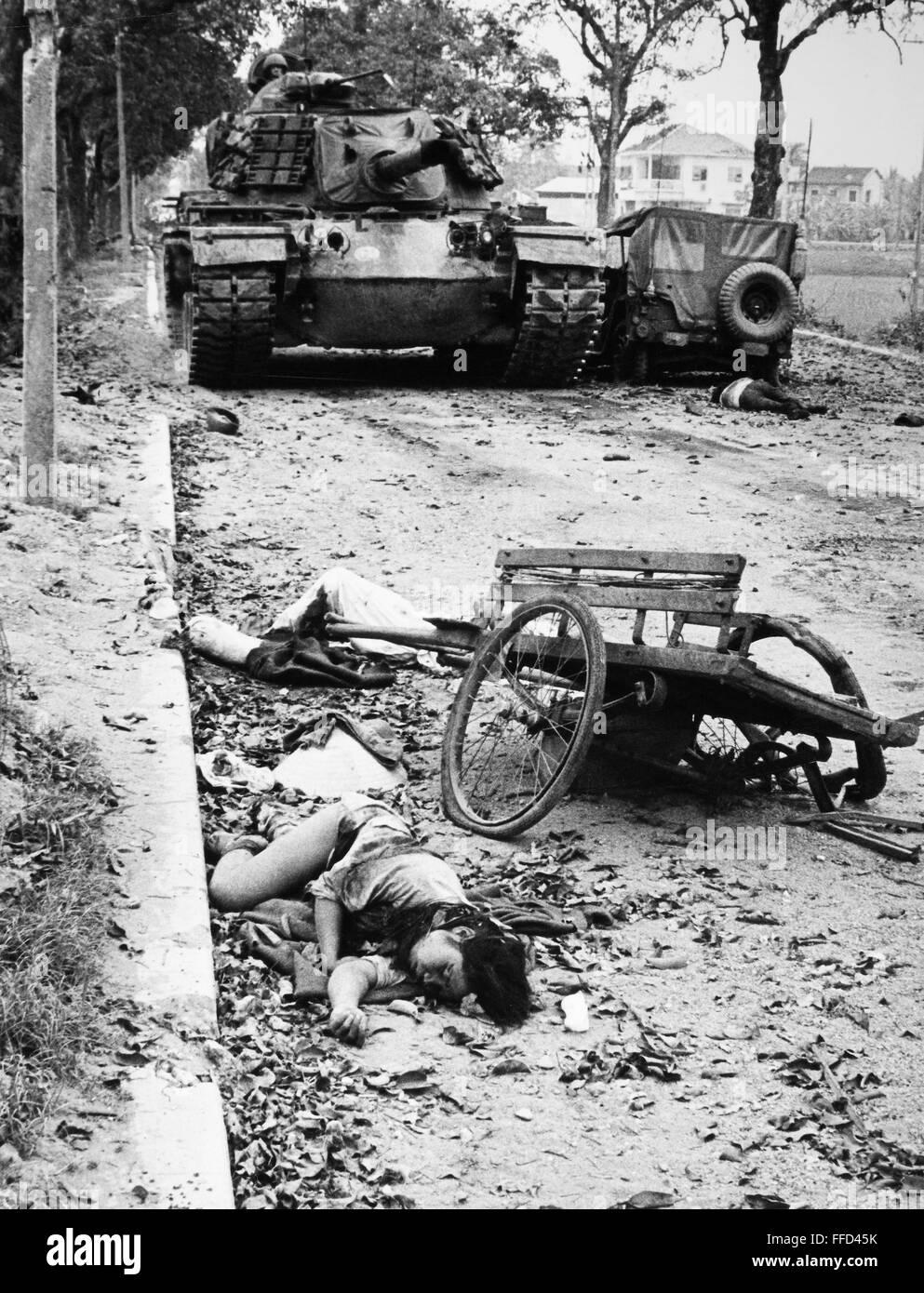 Vietnam War 1954-1975 Vietnam-war-hue-1968-nan-american-tank-passes-the-bodies-of-dead-vietnamese-FFD45K