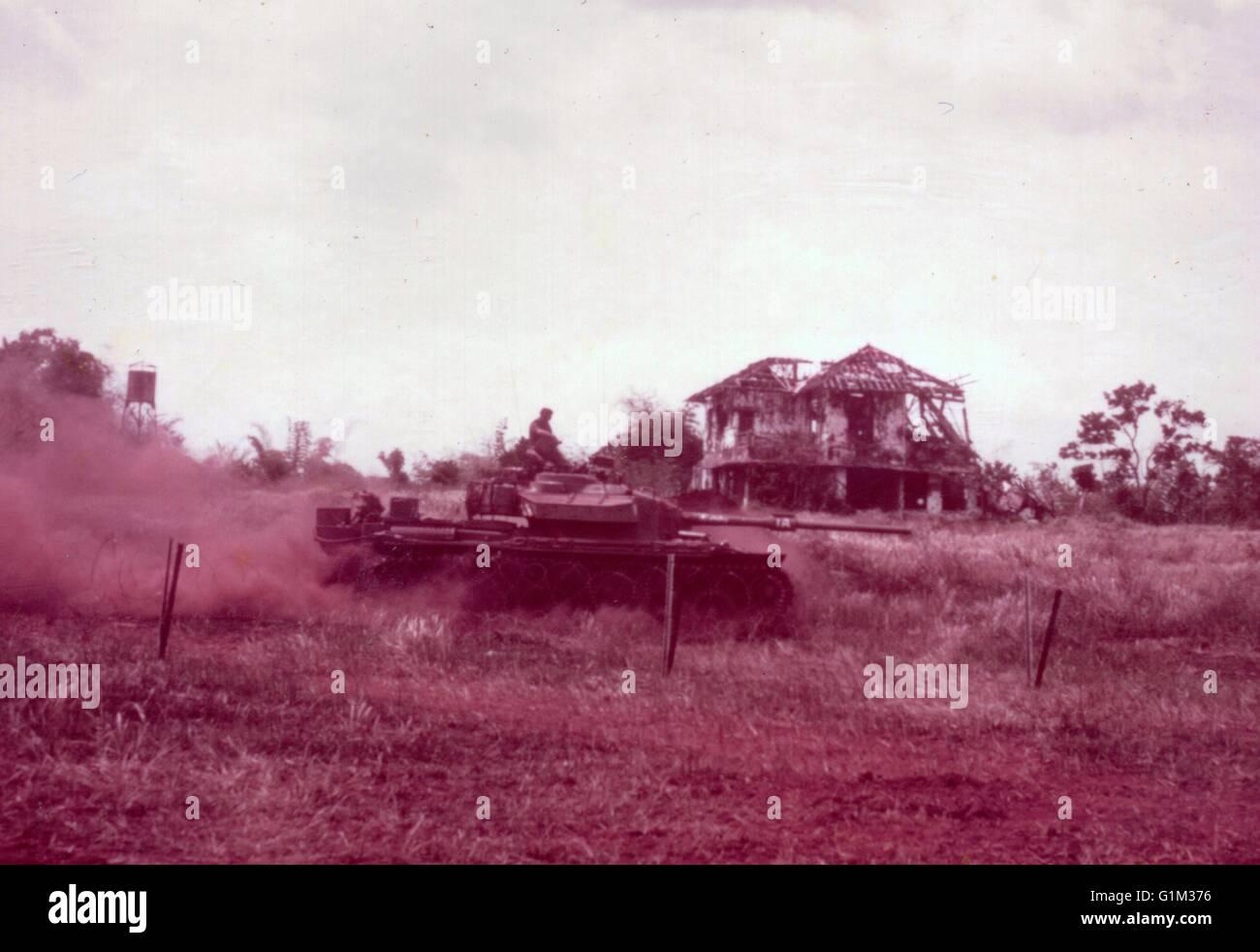 Vietnam War 1954-1975 Australian-centurion-tank-passes-ruins-of-french-colonial-house-phuoc-G1M376