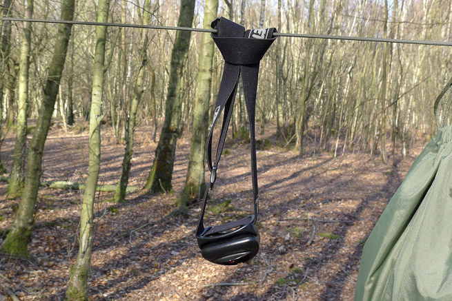 Head torch attached to hanging line by a looped cow hitch.