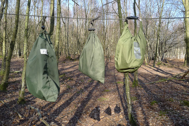 Various bags attached to the hanging line