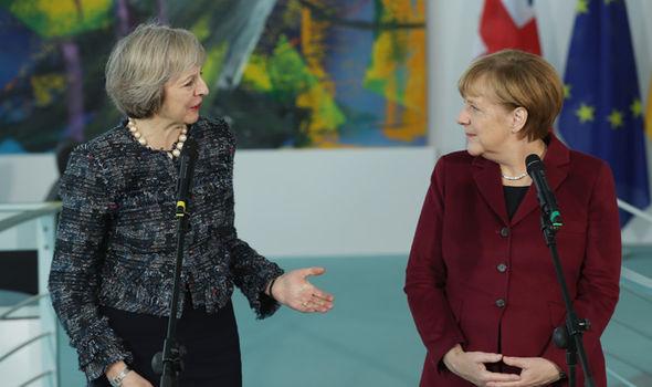 DrMay and MadameMerkel Merkel-deluded-925379