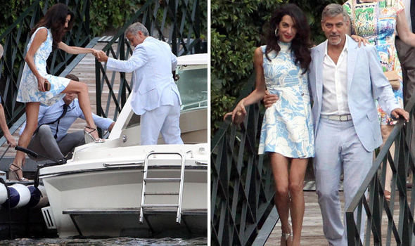 George and Amal Clooney look smitten as they don matching blue hues for date night in Lake Como July 24, 2015 Cloo-593521