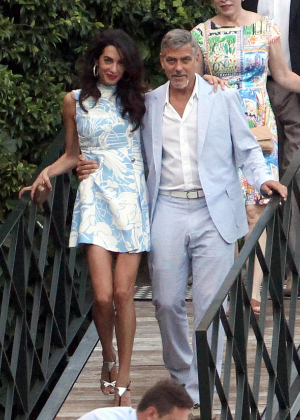 George and Amal Clooney look smitten as they don matching blue hues for date night in Lake Como July 24, 2015 George-and-Amal-Clooney-322015