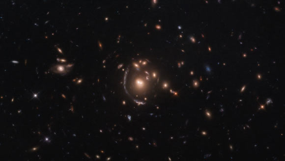 Massive Cluster's Gravity Magnifies Light from Extremely Distant Star-Forming Galaxy Image_9028-LRG-3-817