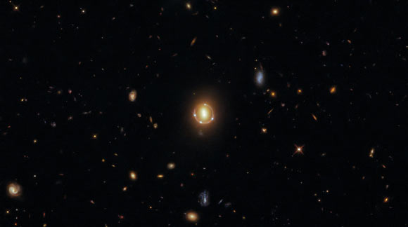 Gravity of Massive Galaxy Pair Magnifies Light from Distant Quasar Image_9938_1-2M1310-1714
