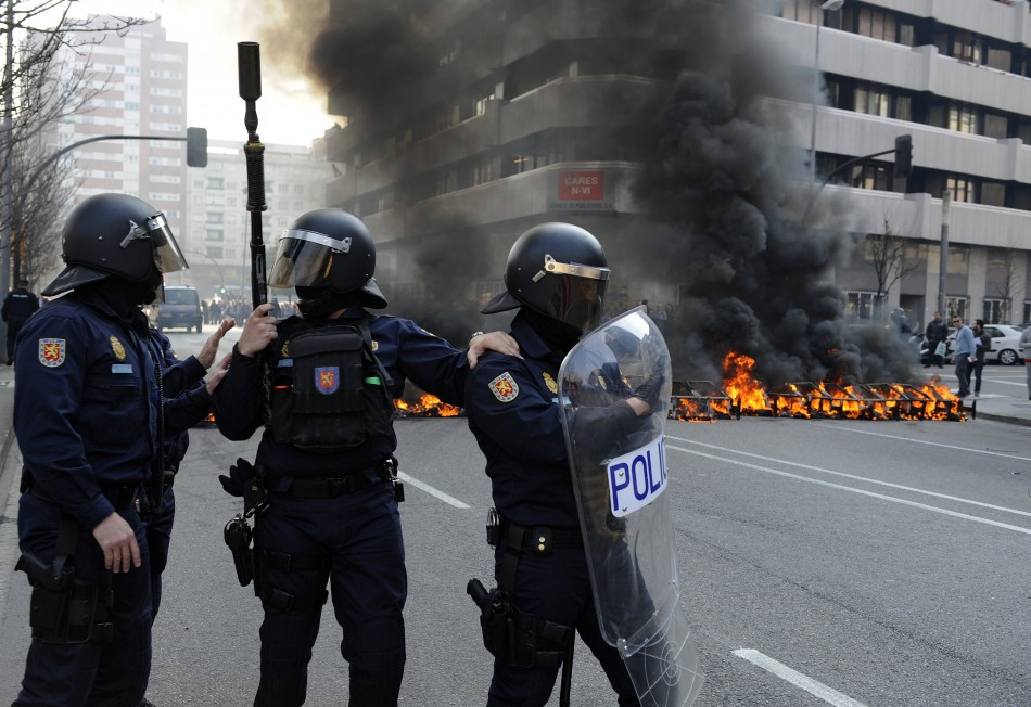 [MP] War in the streets. Riot-police-stand-front-burning-barricade-during-spains-general-strike-gijon