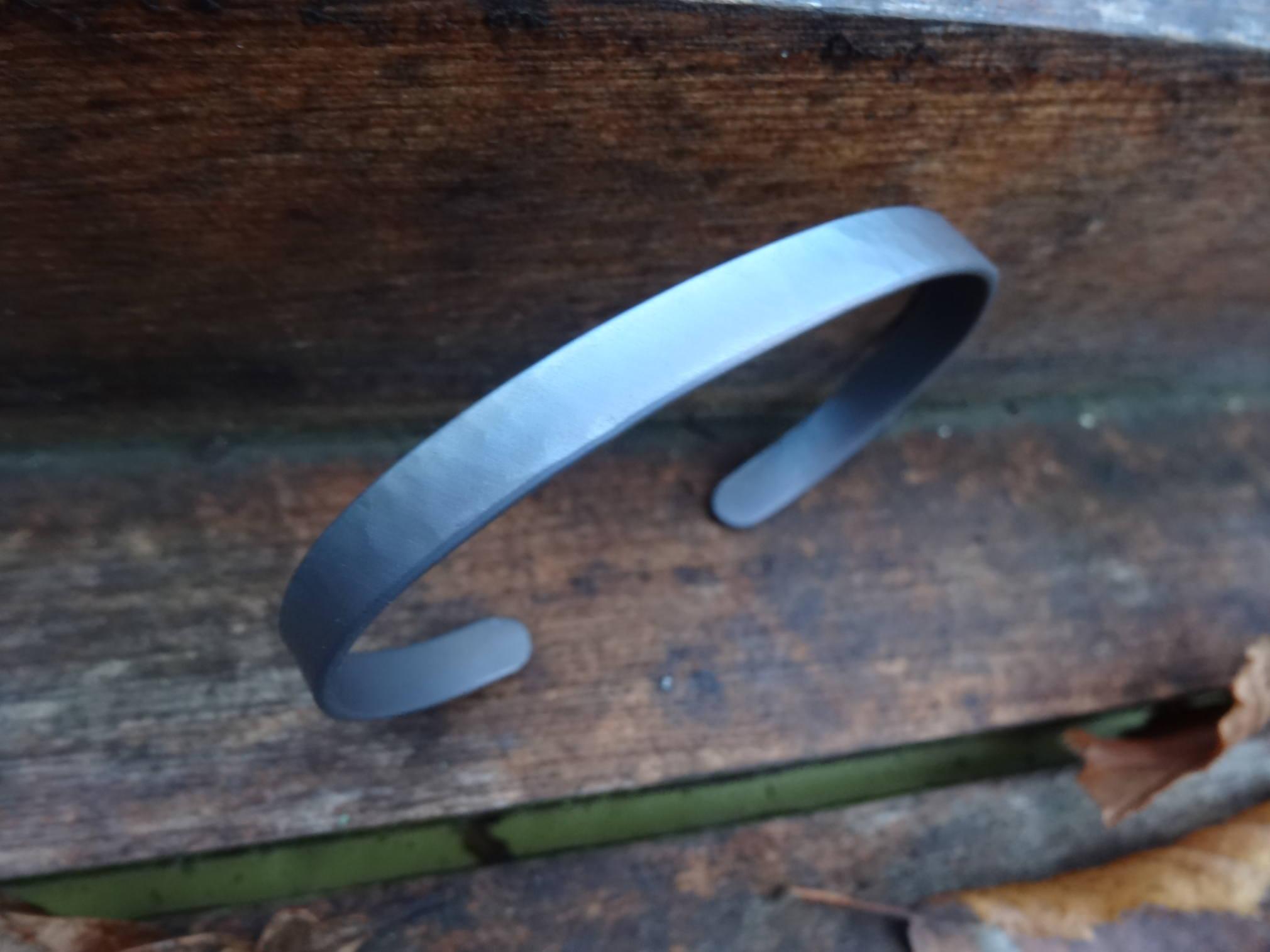 Mes cadeaux de noël (bracelets et bague titane) DSC08235