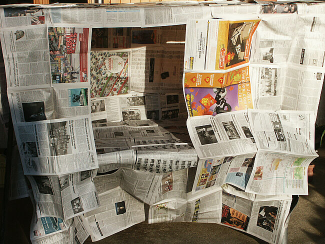 The Newspaper House Paperromain
