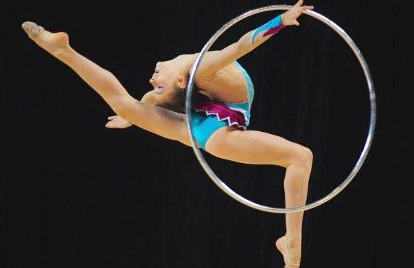 [Jeu] Association d'images - Page 18 GR-gymnastique-rythmique-cerceau-danse-cours-de-danse-enfant