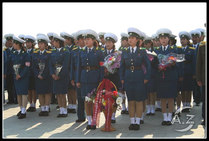 Pyongyang Traffic Ladies honor their Great Leader 3699806537_d637378fd0_o