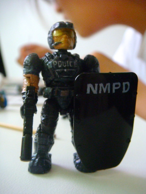 NMPD Police with riot shield! 9089781609_49897199de_z