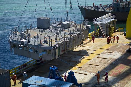 USS Guardian is taken apart.