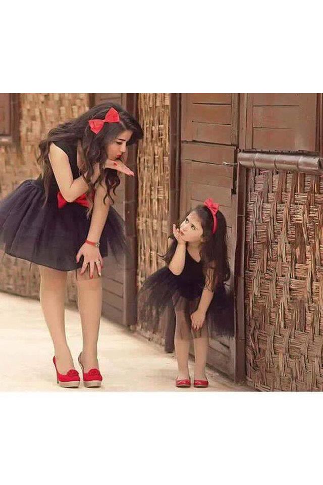 سجل حضورك بصورة ازياء على ذوقك `` - صفحة 7 Large_mother-and-daughter-outfits-fustany-1