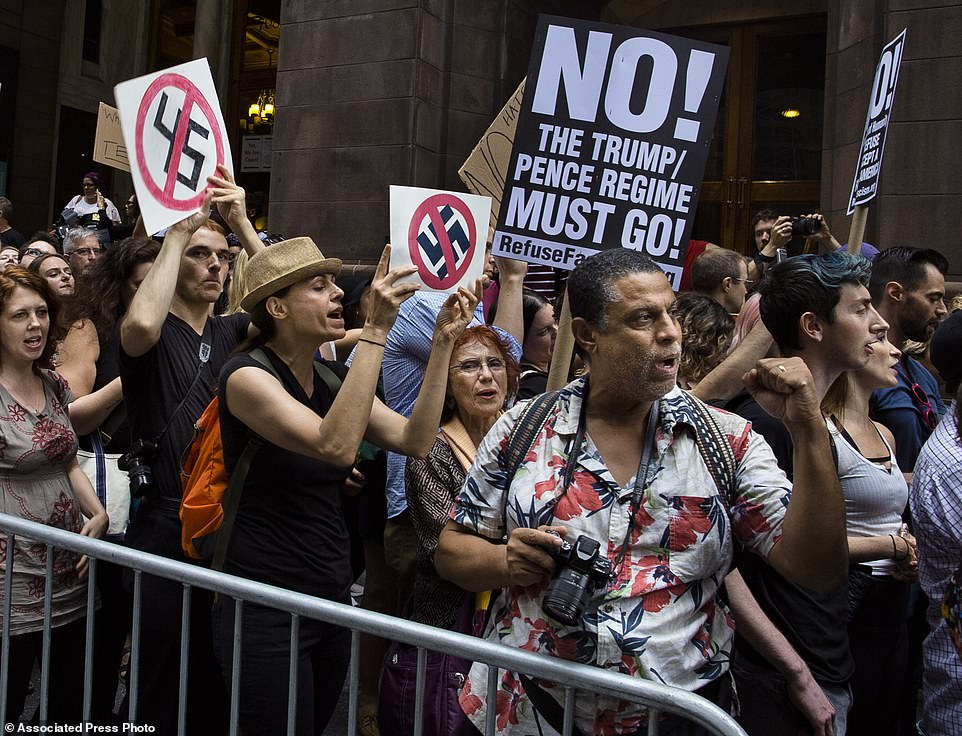 The Serious Side - part 3 - Page 17 1137093-4790620-Protestors_shout_slogans_in_front_of_Trump_Tower_ahead_President-a-6_1502753670774