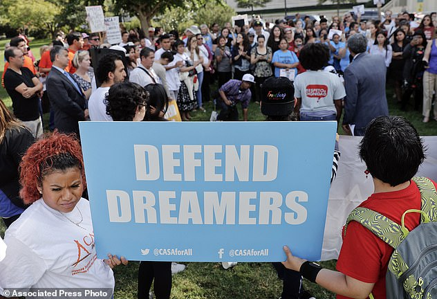 The Serious Side - part 4 - Page 5 1509493-5045463-Just_1_in_5_Americans_want_to_deport_young_immigrants_brought_to-a-17_1509680837879