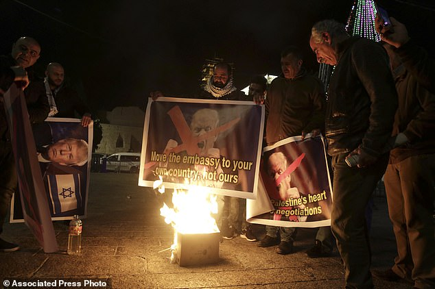 The Serious Side - part 4 - Page 7 1857842-5150649-Palestinians_burned_a_poster_of_Trump_during_a_protest_in_Bethle-a-1_1512569603740