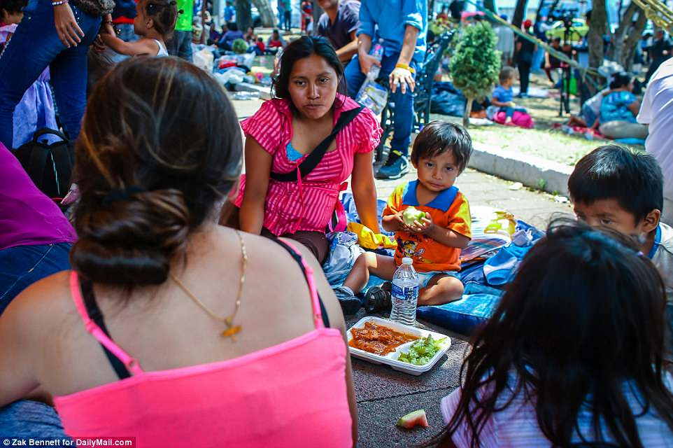 The Serious Side - part 6 - Page 2 4AE53D9200000578-5587745-Chance_to_rest_Migrant_families_rest_outside_Iglesia_Nuestra_Sen-a-26_1523061957338