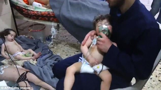 The Serious Side - part 6 - Page 2 4AF246B000000578-5591957-An_image_grab_taken_from_a_video_released_by_the_Syrian_Civil_De-a-23_1523283224456