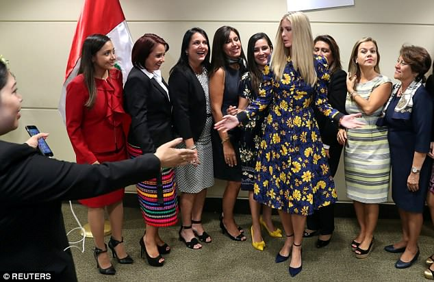 The Serious Side - part 6 - Page 3 4B17715000000578-5609411-Meet_and_greet_Ivanka_also_shook_hands_during_the_photo_op_with_-a-6_1523578546150