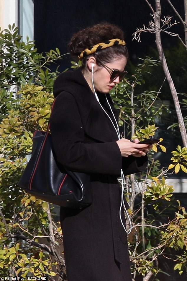 She May Be Texting Brad 4B66954A00000578-0-image-a-29_1524338582265