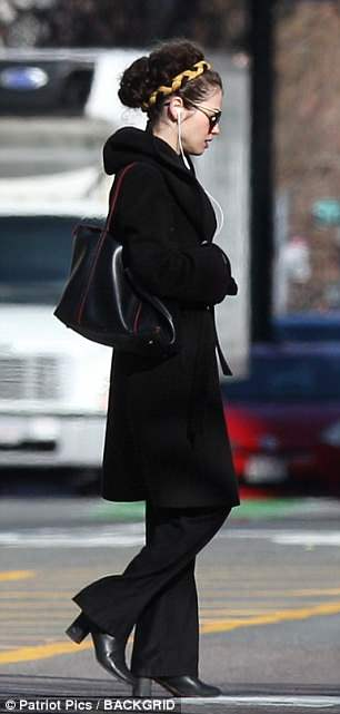 She May Be Texting Brad 4B669B8A00000578-5642489-Back_in_black_The_academic_looked_chic_in_a_black_coat_over_dark-a-155_1524342407206