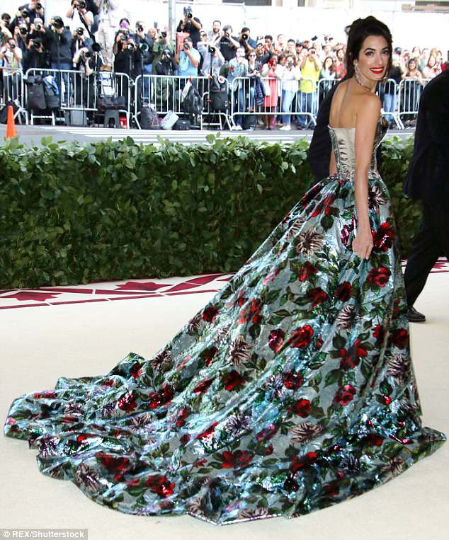 George and Amal Clooney Later at after party after the Met Gala2918 4BF3EDBC00000578-0-Dramatic_The_outfit_was_certainly_eye_catching_as_it_offered_a_v-a-3_1525781490721