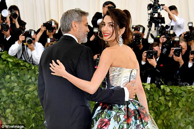 George and Amal Clooney Later at after party after the Met Gala2918 4BF3EFB400000578-0-She_sure_nailed_her_glam_The_brunette_wore_her_hair_swept_up_wit-a-4_1525781490741