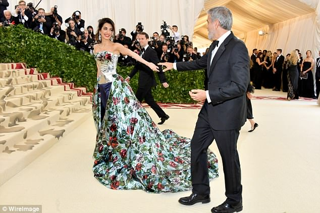 George and Amal Clooney Later at after party after the Met Gala2918 4BF3F3EA00000578-0-Almost_touching_The_two_seemed_to_struggle_to_join_hands_before_-a-2_1525781490699
