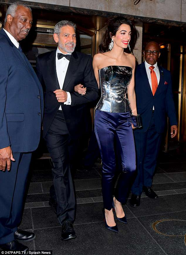 George and Amal Clooney Later at after party after the Met Gala2918 4BF5263100000578-0-Party_time_Later_Amal_cleverly_whipped_off_her_dramatic_train_to-a-11_1525781490928