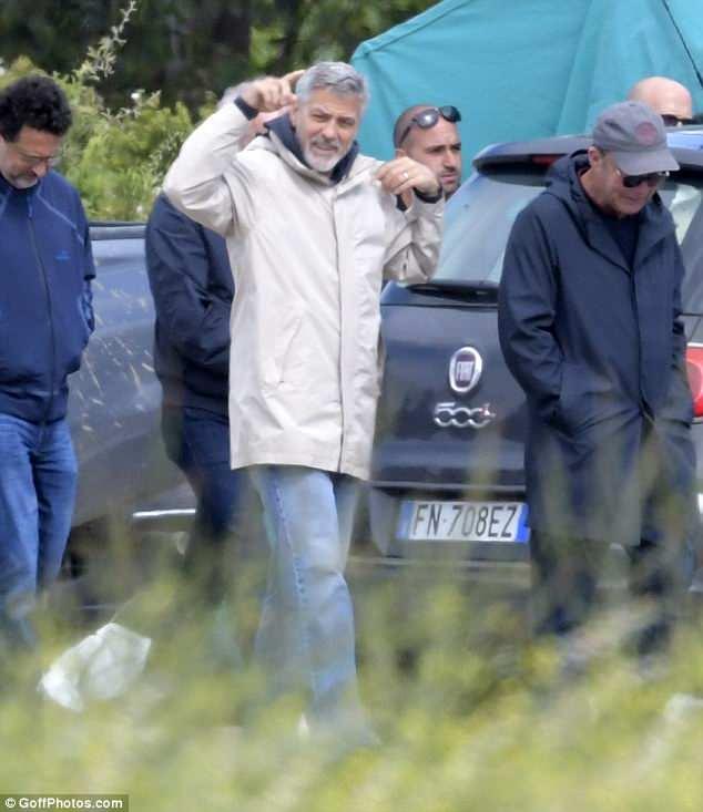 George at work in Sardegna? 4C427B9C00000578-0-image-m-16_1526378718132