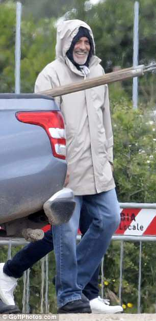 George at work in Sardegna? 4C427CD000000578-0-image-m-53_1526380020682