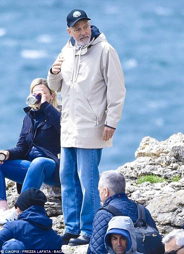 George at work in Sardegna? 4C4E390200000578-0-image-m-78_1526467914439