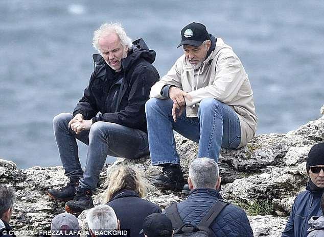 George at work in Sardegna? 4C4E35CC00000578-0-image-m-106_1526469019265