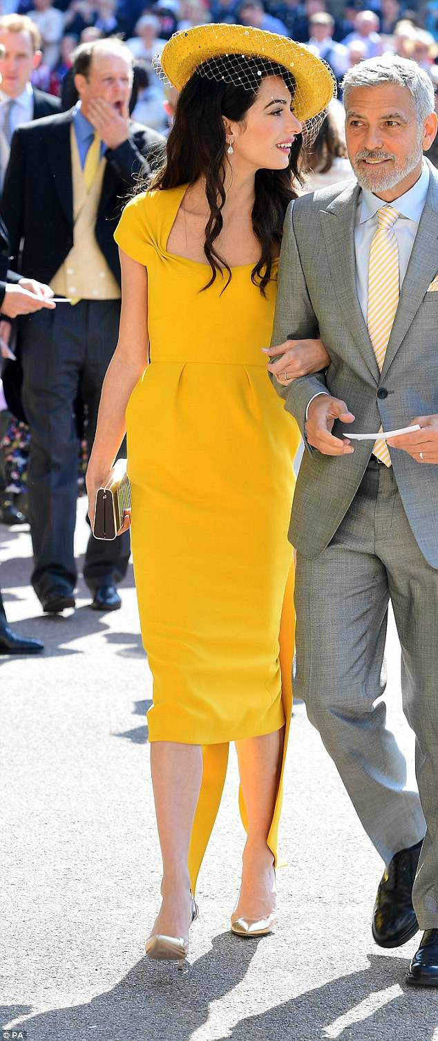 George and Amal Clooney at the Royal Wedding - Page 2 4C7134D700000578-5751241-Amal_Clooney_chose_a_marigold_dress_by_Stella_McCartney_with_a_b-a-26_1526885491539
