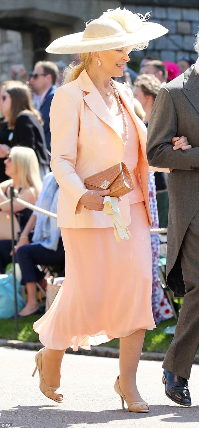 George and Amal Clooney at the Royal Wedding - Page 2 4C7134FB00000578-5751241-Princess_Michael_of_Kent_s_outfit_is_a_bit_salmony_but_she_doesn-a-25_1526885491527