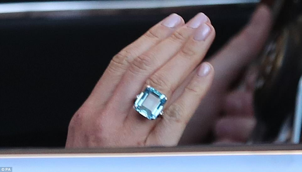 George and Amal at Royal Wedding evening reception Frogmore House 4C72C8D900000578-5751749-A_close_up_of_the_emerald_cut_aquamarine_ring_which_Meghan_Markl-a-1_1526884809990