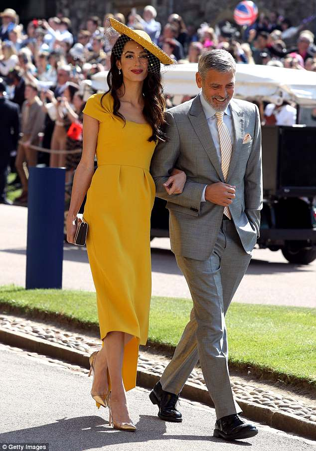 George and Amal Clooney at the Royal Wedding - Page 2 4C6E83E600000578-0-image-a-30_1526900426138